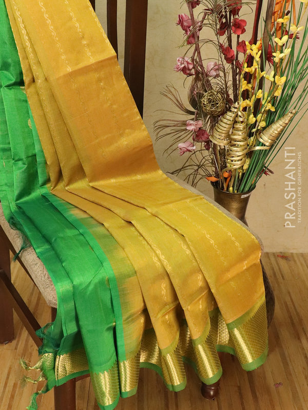 Silk cotton partly saree golden yellow and green with zari lines and zari woven border