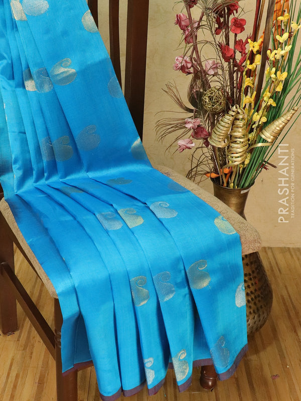 Silk cotton saree cs blue and coffee brown with zari woven buttas and piping border