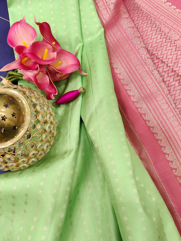 Pure kanchivaram silk saree pista green and baby pink with silver zari woven 1000 buttas in borderless style