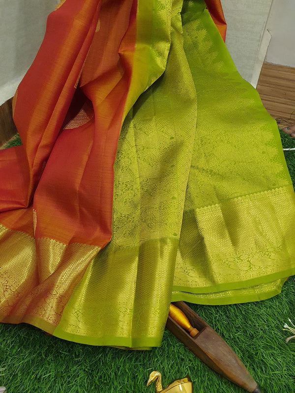 Pure kanchivaram silk saree dual shade of orange pink and green with golden zari woven buttas and zari woven border