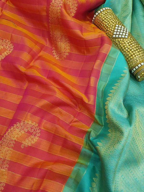 Pure kanchivaram silk saree orange pink and teal with golden zari lines and paisley buttas in piping border