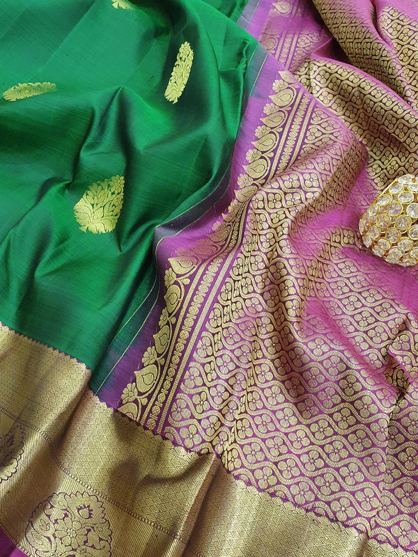 Pure kanchivaram silk saree green and magenta with golden zari woven buttas and zari woven border