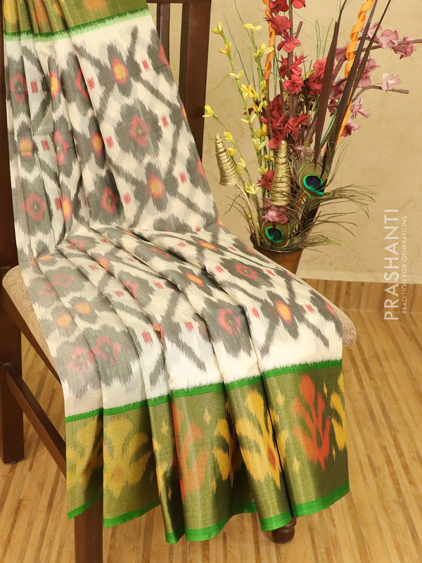 Ikat silk cotton saree off white and green with ikat woven long zari border