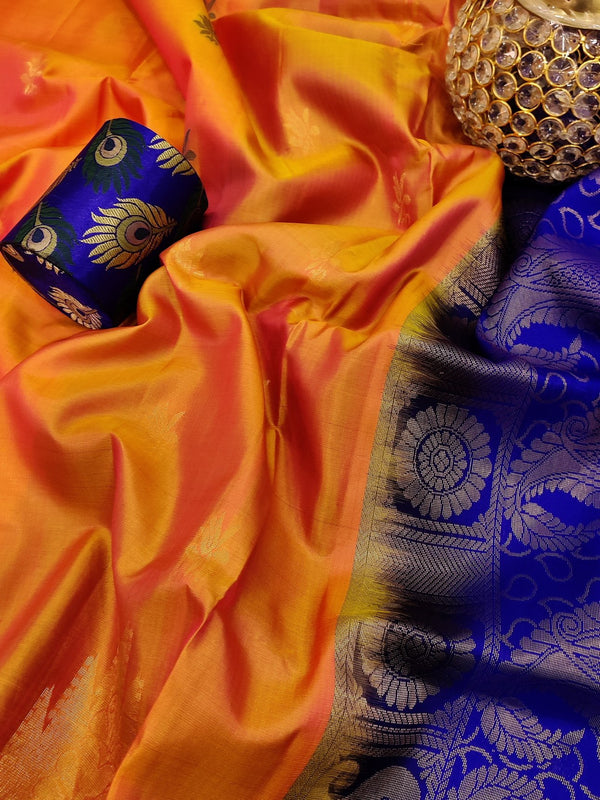 Pure soft silk saree dual shade of mild orange with thread and zari woven buttas in temple style border