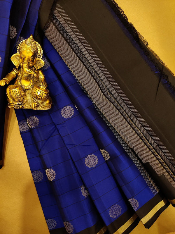 Pure soft silk saree blue and black with allover stripes and buttas in simple zari border