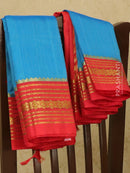Kuppadam silk cotton saree blue and red with plain body and zari woven border