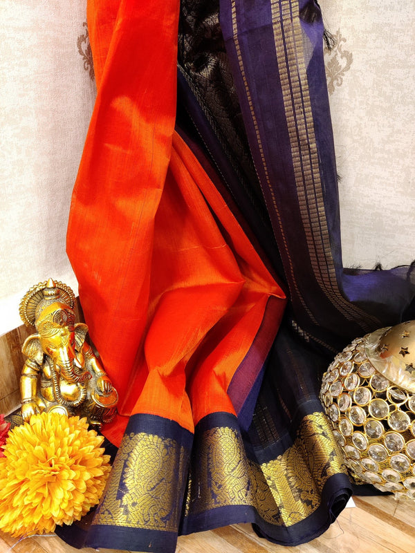 Silk cotton saree orange and navy blue with rich korvai zari border