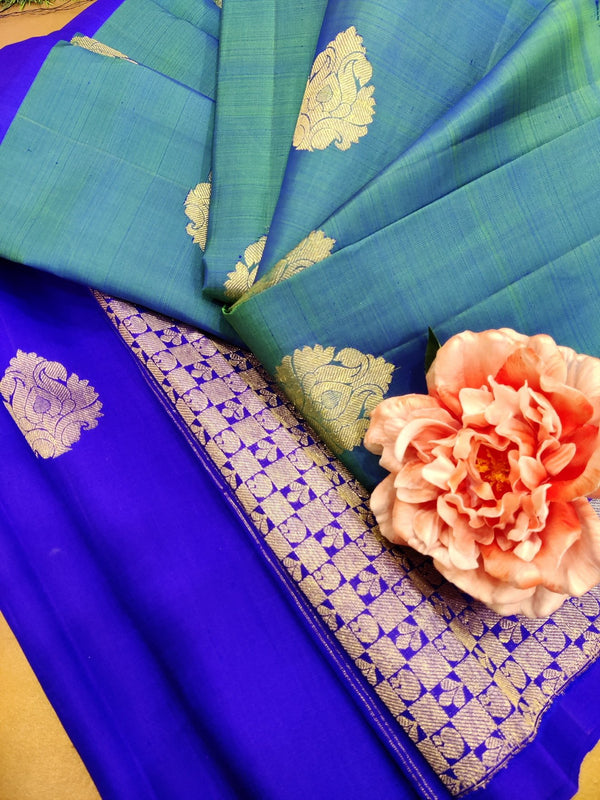 Pure Kanjivaram silk saree dual shade of green and violet with golden zari woven buttas in half and half style