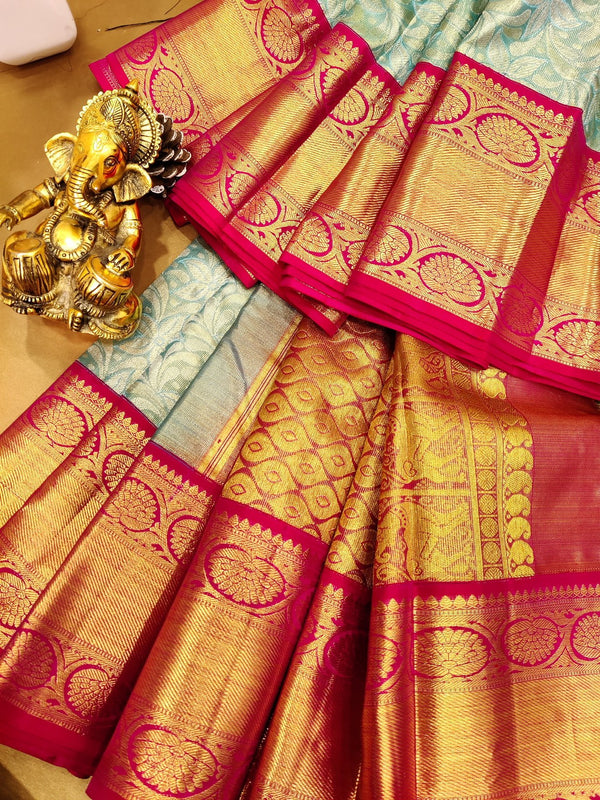 Pure Kanjivaram silk tissue saree light blue and pink with allover golden and silver zari weaves and zari border