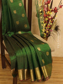 Pure Kanjivaram silk saree green with allover golden zari checks and buttas with zari woven border