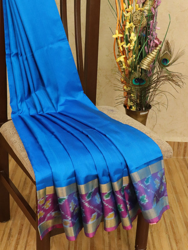 Pure Uppada silk saree blue and pink with plain body and ikat woven border