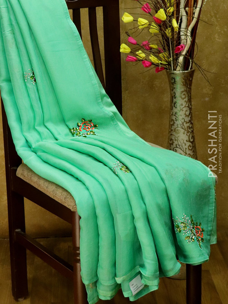 Jute georgette saree sea green with sequin work and piping border