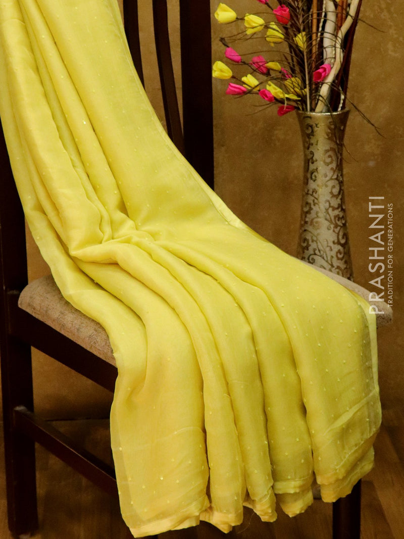 Jute georgette saree yellow with sequin work hand embroided and piping border for Rs.Rs. 11550.00 | by Prashanti Sarees