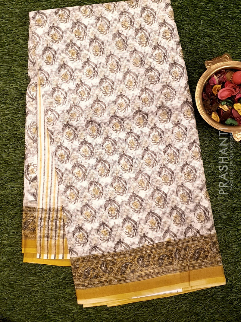 Kota Doria saree white and yellow with all over floral prints