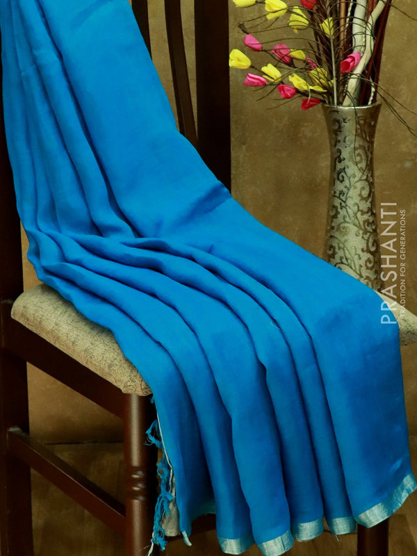 Pure Linen sarees cs blue with silver zari border and embroided blouse