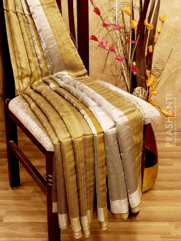 Pure Matka saree honey with allover silver zari checks and border