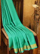 Mysore Crepe Silk Saree teal and pink with allover self emboss and golden zari border