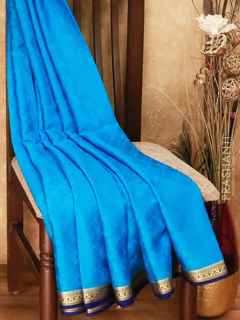 Mysore Crepe Silk Saree cs blue and blue  with allover self emboss and golden zari border
