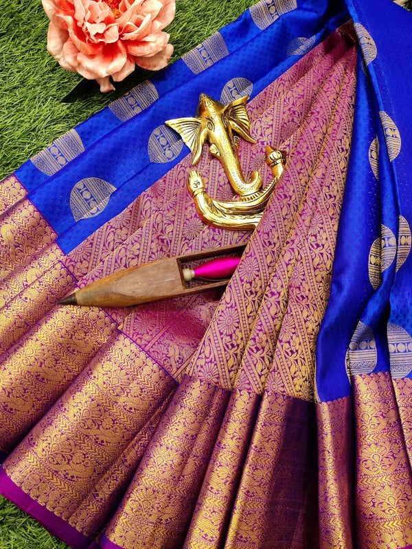 Pure Kanchivaram Silk saree blue and pink with self emboss and buttas with zari woven border