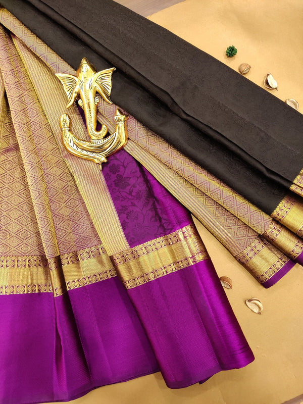 Pure Kanchivaram Silk saree black and purple with self emboss and buttas with simple border