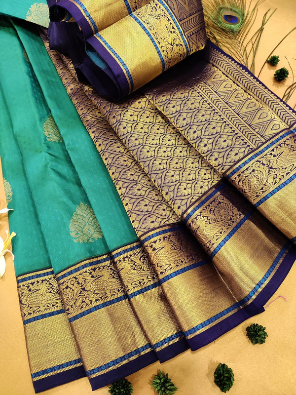 Pure Kanchivaram Silk saree green and navy blue with self emboss and buttas with zari woven border