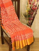Pure linen saree orange with allover batik prints and simple border