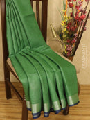 Pure linen saree green and blue with plain body and zari border
