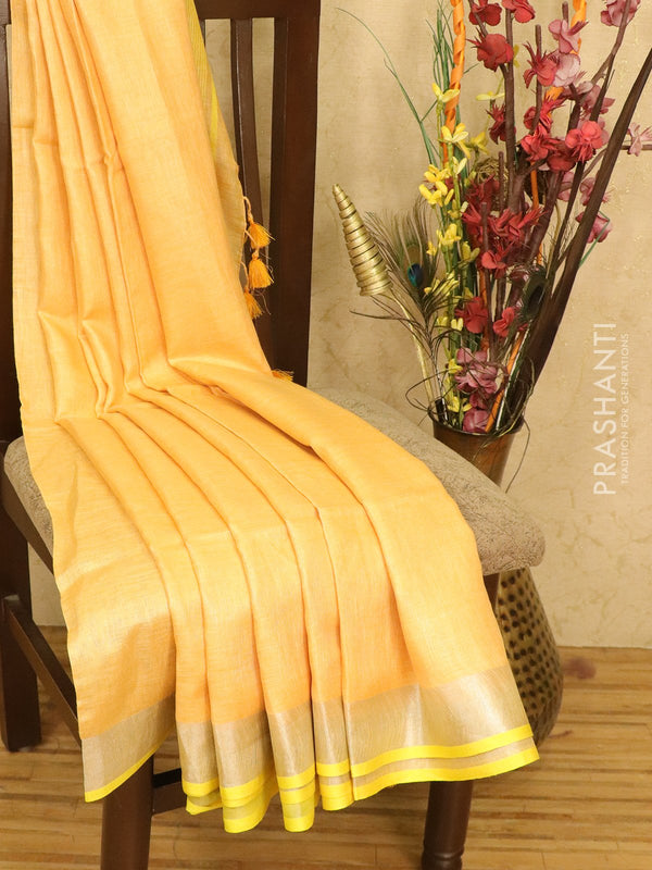 Pure linen saree peachish orange with plain body and zari border