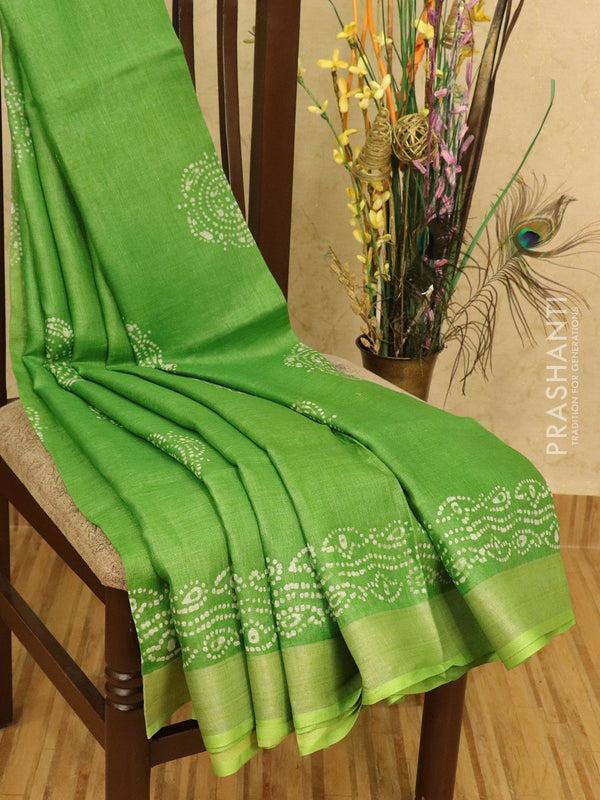 Pure linen saree green with batik prints and zari border