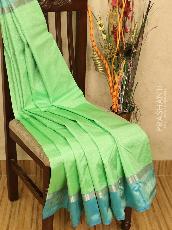 Roopam Silk sarees pista green and blue with allover self emboss and simple zari border