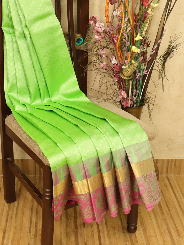 Roopam Silk sarees green and pink allover self emboss with zari and thread woven border