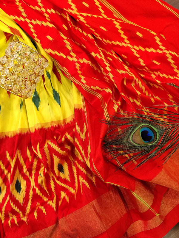 Pochampally silk saree lime yellow and brick orange with ikat weaves and zari woven ikat border