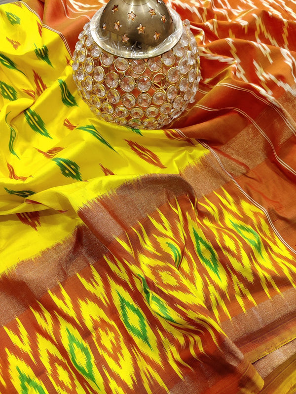 Pochampally silk saree yellow and mustard orange with ikat weaves and zari woven ikat border