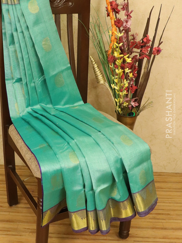 Silk cotton saree sea green and violet with zari woven buttas and zari woven temple border