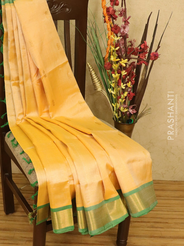 Silk cotton saree cream and green with zari woven buttas and zari woven border