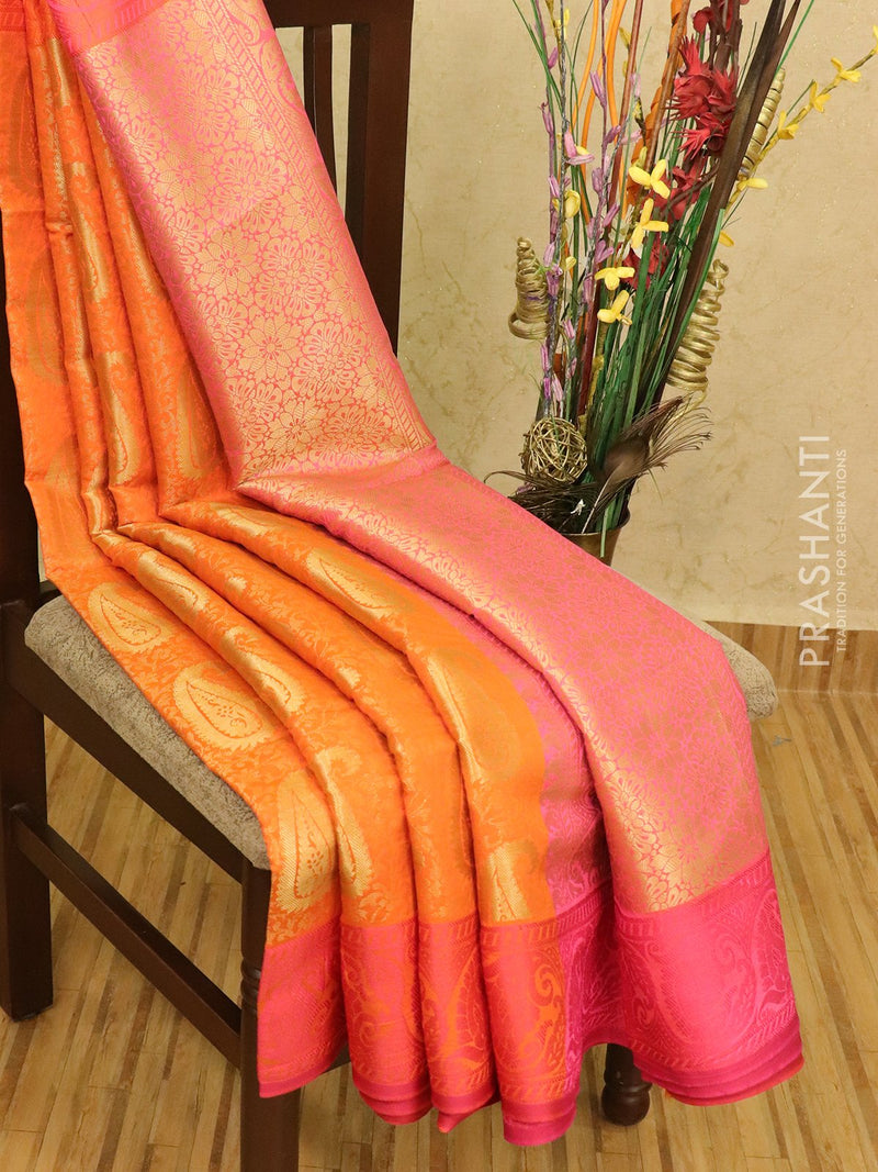 Semi dupion saree orange and pink with allover zari weaves and thread woven border