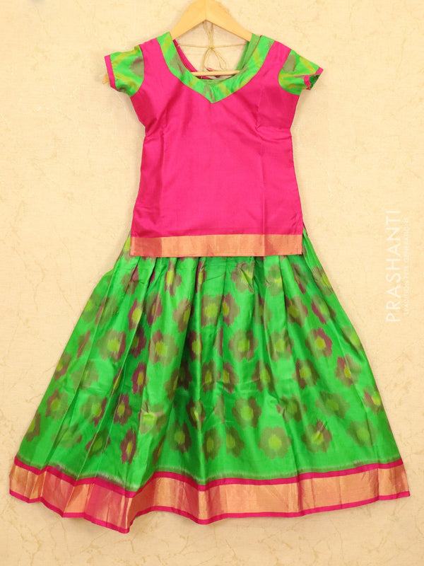 Silk pavadai sattai green and pink with allover ikat weaves and zari border for 9 years