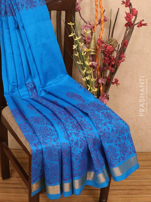 Silk cotton block printed saree cs blue with floral prints and zari woven border