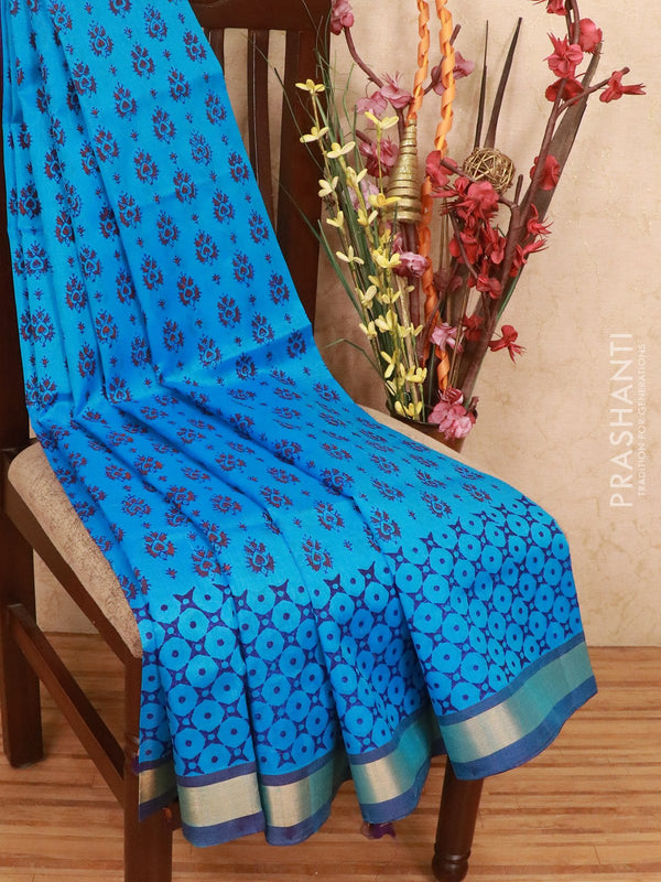 Silk cotton block printed saree cs blue and violet with allover prints and zari woven border