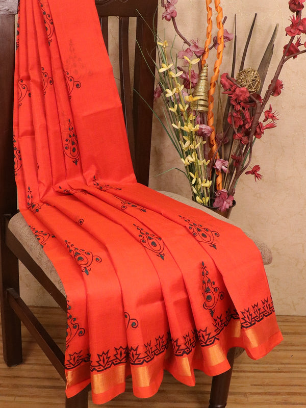 Silk cotton block printed saree orange with simple prints and zari border