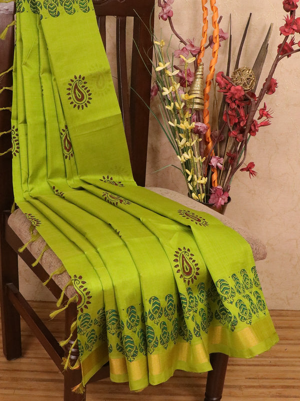 Silk cotton block printed saree light green with paisley prints and simple zari border