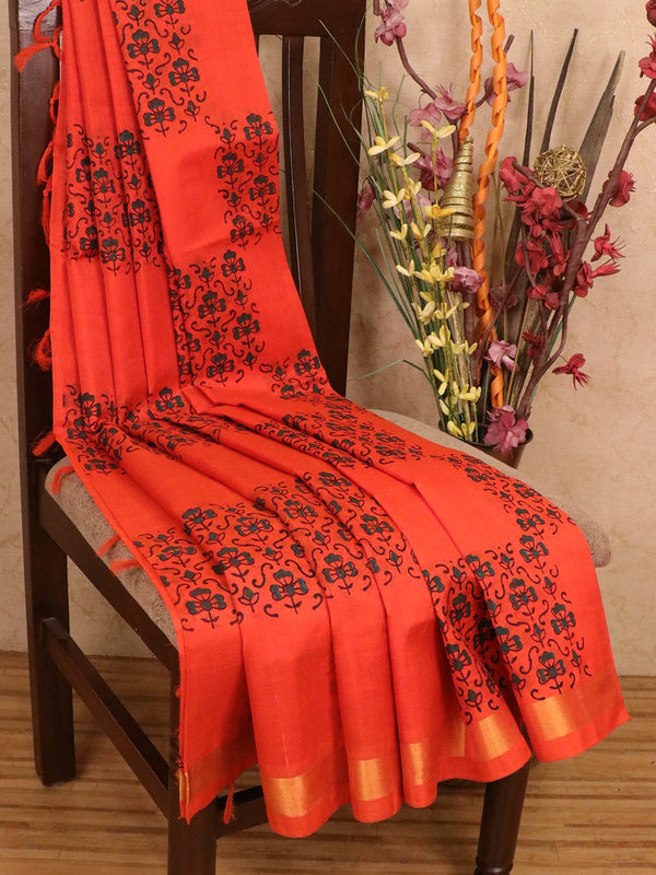 Silk cotton block printed saree orange with floral geometric prints and zari border