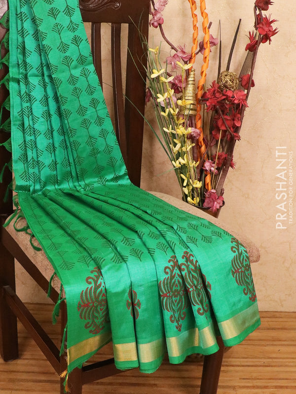 Silk cotton block printed saree green with allover prints and simple zari border
