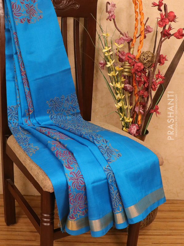 Silk cotton block printed saree cs blue with floral geometric prints and simple zari border
