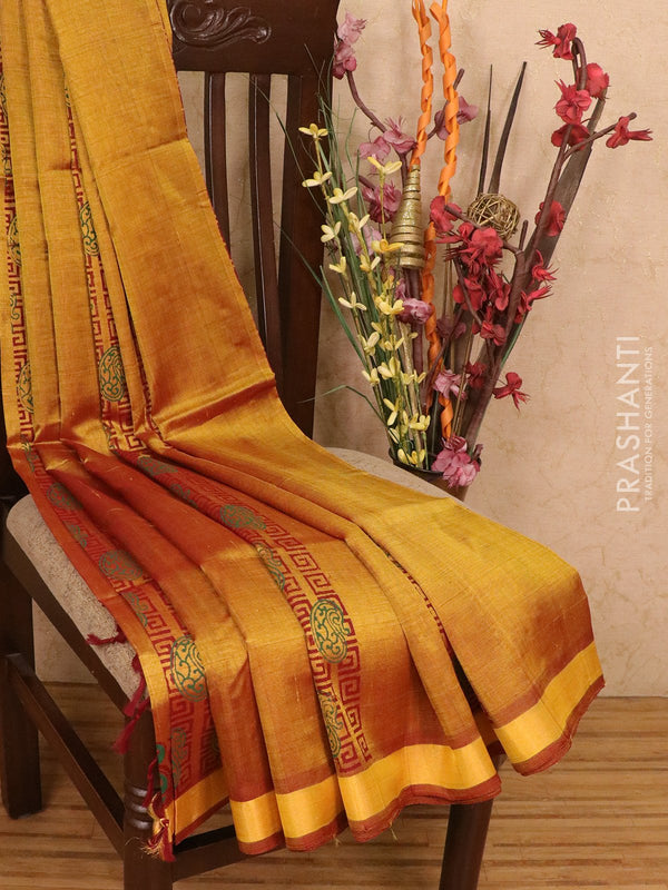 Silk cotton block printed saree golden rust with allover prints and zari woven border