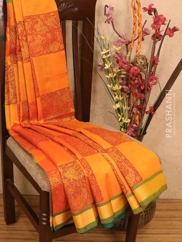 Silk cotton block printed saree orange and green with box type buttas and zari woven border