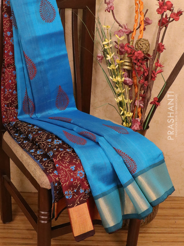 Silk cotton block printed partly saree cs blue and maroon with floral prints and zari woven border