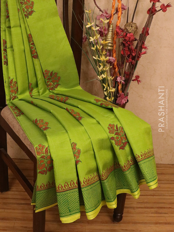 Silk cotton block printed saree light green with floral prints and printed border