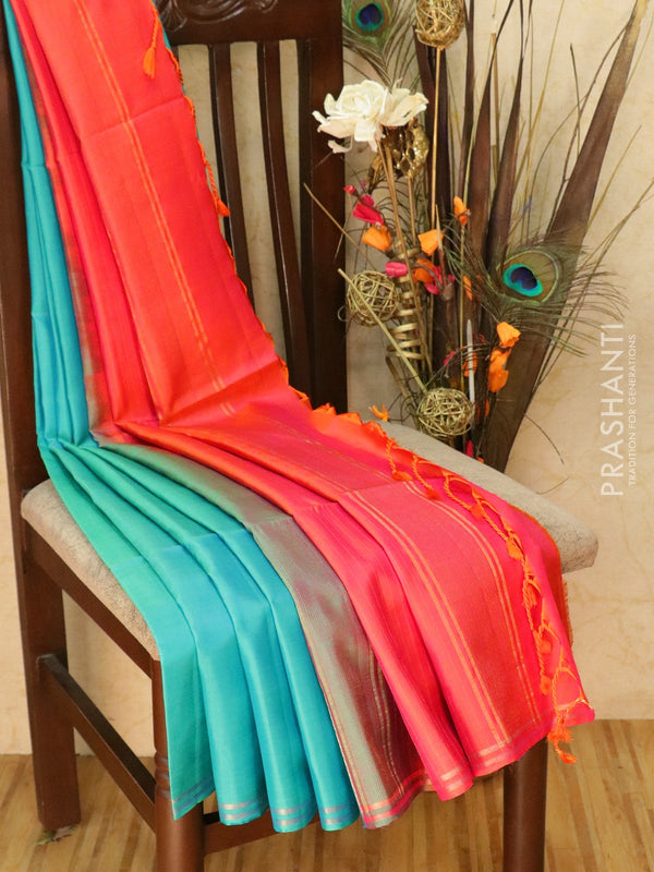 Pure Soft silk saree teal and orangish pink with plain body and zari lines pallu