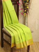 Kora silk cotton saree green and orange with zari border and body buttas
